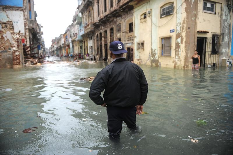 A Cuban wades through a flooded street in Havana, on September 10, 2017. Deadly Hurricane Irma battered central Cuba on Saturday, knocking down power lines, uprooting trees and ripping the roofs off homes as it headed towards Florida. Authorities said they had evacuated more than a million people as a precaution, including about 4,000 in the capital. / AFP PHOTO / YAMIL LAGE (Photo credit should read YAMIL LAGE/AFP/Getty Images)