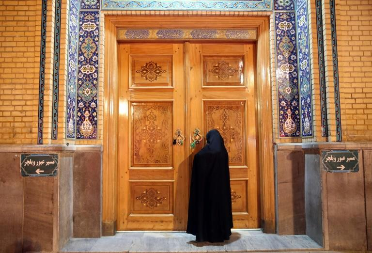 Iranian mosques and shrines, like the Fatima Masumeh shrine in the Shiite holy city of Qom, have been closed since March as part of government efforts to stem the spread of the coronavirus