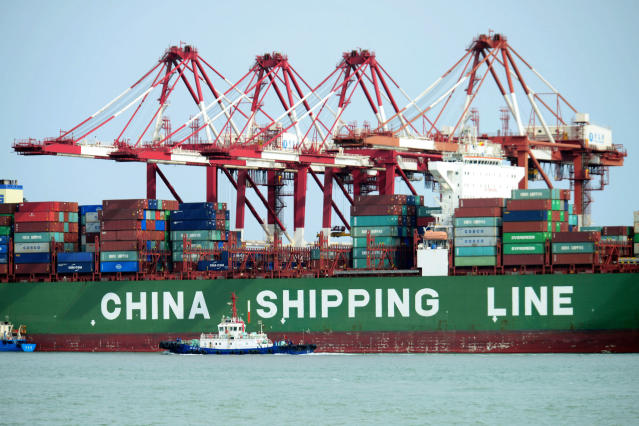 FILE – In this April 13, 2018, file photo, a China Shipping container ship is seen at the port in Qingdao in eastern China's Shandong province. China has accused the United States on Thursday, June 21, 2018, of using pressure tactics and blackmail in threatening to impose tariffs on hundreds of billions of dollars of Chinese imports. (Chinatopix via AP, File)
