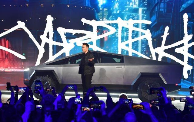Tesla and Ford trade challenges in macho truck world
