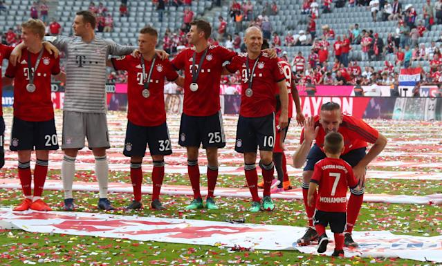 Soccer Football - Bundesliga - Bayern Munich v VfB Stuttgart - Allianz Arena, Munich, Germany - May 12, 2018 Bayern Munich's Franck Ribery celebrates winning the Bundesliga with a child, Arjen Robben, Thomas Mueller and team mates REUTERS/Michael Dalder DFL RULES TO LIMIT THE ONLINE USAGE DURING MATCH TIME TO 15 PICTURES PER GAME. IMAGE SEQUENCES TO SIMULATE VIDEO IS NOT ALLOWED AT ANY TIME. FOR FURTHER QUERIES PLEASE CONTACT DFL DIRECTLY AT + 49 69 650050