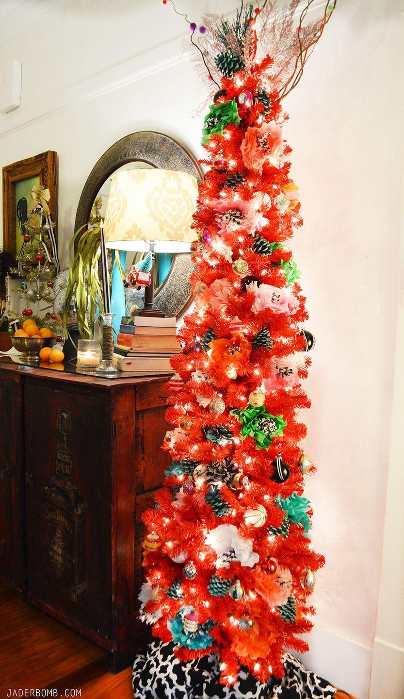 """<p>If you're a big fan of bright colors, this is the Christmas tree for you. It'll brighten up any room and transport your family to their own colorful, flower-filled winter wonderland. </p><p><strong><em>Get the tutorial at <a href=""""https://jaderbomb.com/boho-red-christmas-tree/"""" rel=""""nofollow noopener"""" target=""""_blank"""" data-ylk=""""slk:JaderBomb"""" class=""""link rapid-noclick-resp"""">JaderBomb</a>.</em></strong></p><p><a class=""""link rapid-noclick-resp"""" href=""""https://www.amazon.com/Natural-Decorative-Winter-Holiday-Filler/dp/B075Q98P4D/?tag=syn-yahoo-20&ascsubtag=%5Bartid%7C10070.g.2025%5Bsrc%7Cyahoo-us"""" rel=""""nofollow noopener"""" target=""""_blank"""" data-ylk=""""slk:BUY SCENTED PINE CONES"""">BUY SCENTED PINE CONES</a></p>"""