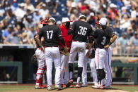 North Carolina State players meet on the mound around starting pitcher Garrett Payne (36) in the fourth inning against Vanderbilt during a baseball game in the College World Series, Friday, June 25, 2021, at TD Ameritrade Park in Omaha, Neb. (AP Photo/Rebecca S. Gratz)