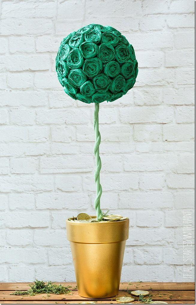 """<p>Once you make all the crepe paper rosettes, you can put together the rest of this lovely St. Patrick's Day topiary.</p><p><strong>Get the tutorial at <a href=""""https://www.itallstartedwithpaint.com/pot-gold-topiary/"""" rel=""""nofollow noopener"""" target=""""_blank"""" data-ylk=""""slk:It All Started with Paint"""" class=""""link rapid-noclick-resp"""">It All Started with Paint</a>.</strong></p><p><a class=""""link rapid-noclick-resp"""" href=""""https://www.amazon.com/s?k=terra+cotta+pots&tag=syn-yahoo-20&ascsubtag=%5Bartid%7C2164.g.35012898%5Bsrc%7Cyahoo-us"""" rel=""""nofollow noopener"""" target=""""_blank"""" data-ylk=""""slk:SHOP TERRA COTTA POTS"""">SHOP TERRA COTTA POTS</a><br></p>"""