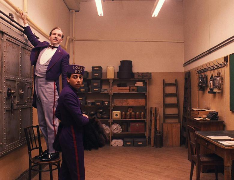 """This image released by Fox Searchlight shows Ralph Fiennes, left, and Tony Revolori in """"The Grand Budapest Hotel. Sandwiched between the swaggering spectacle of summer and the chest-thumping ambition of awards season, spring moviegoing is usually an afterthought, a limbo for films not bankable enough for July or sufficiently arty-seeming for Oscar. But this season, the movies are alive. (AP Photo/Fox Searchlight)"""