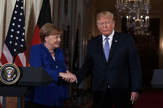 The vibe between President Trump and German Chancellor Angela Merkel was off. (Photo: Getty Images)