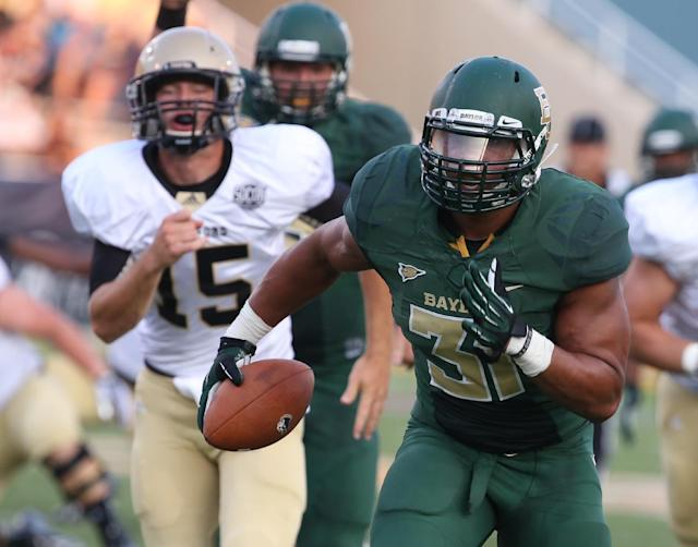 Baylor defensive end Chris McAllister (31) runs past Wofford quarterback Michael Weimer (15) for a touchdown on an interception during the first half of an NCAA college football game on Saturday, Aug. 31, 2013, in Waco, Texas. (AP Photo/Waco Tribune Herald, Rod Aydelotte)