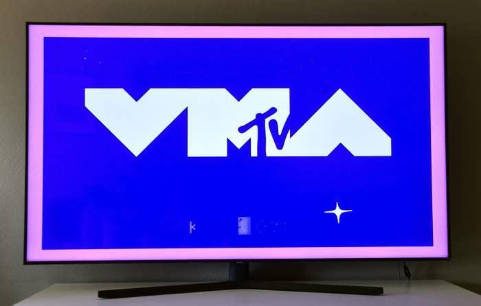 An illustration of the MTV VMAs logo on a bright blue background