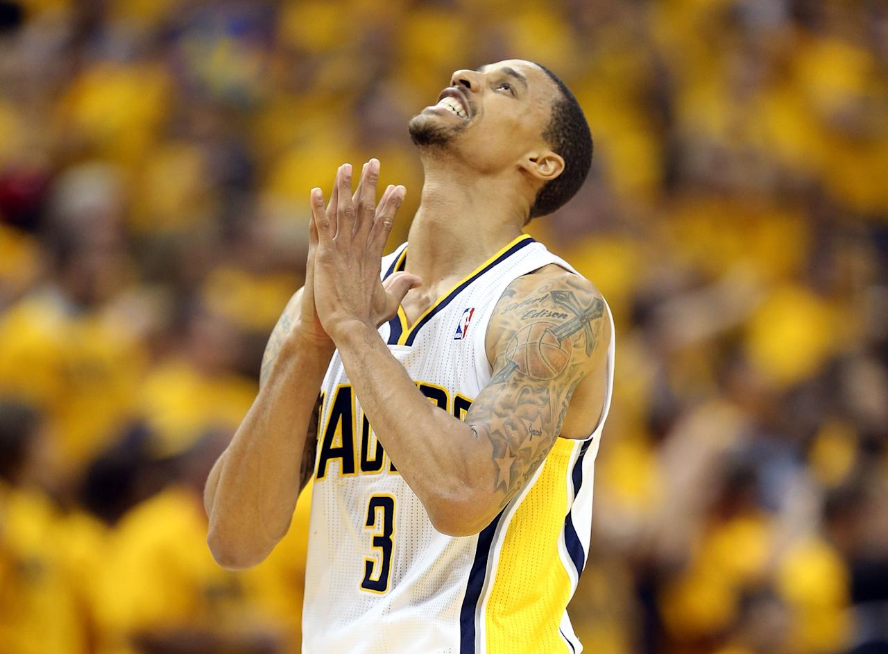 INDIANAPOLIS, IN - MAY 18:  George Hill #3 of the Indiana Pacers celebrates in the game against the New York Knicks during Game Six of the Eastern Conference Semifinals of the 2013 NBA Playoffs at Bankers Life Fieldhouse on May 18, 2013 in Indianapolis, Indiana.The Pacers won 106-99. NOTE TO USER: User expressly acknowledges and agrees that, by downloading and or using this photograph, User is consenting to the terms and conditions of the Getty Images License Agreement.  (Photo by Andy Lyons/Getty Images)