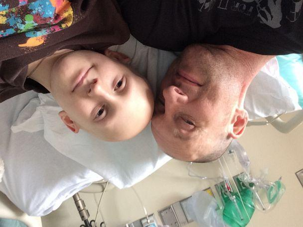 PHOTO: 10-year-old cancer patient Ian Dowling pictured with his dad Brett Dowling during a hospital stay. (Brett Dowling)