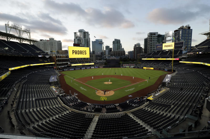 AP PHOTOS: Empty stands, masked players as baseball returns