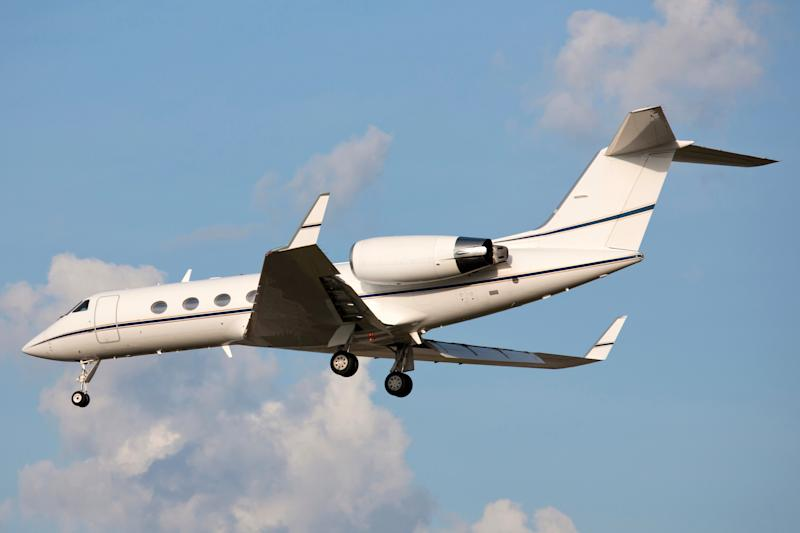 Gulfstream jet with landing gear extending