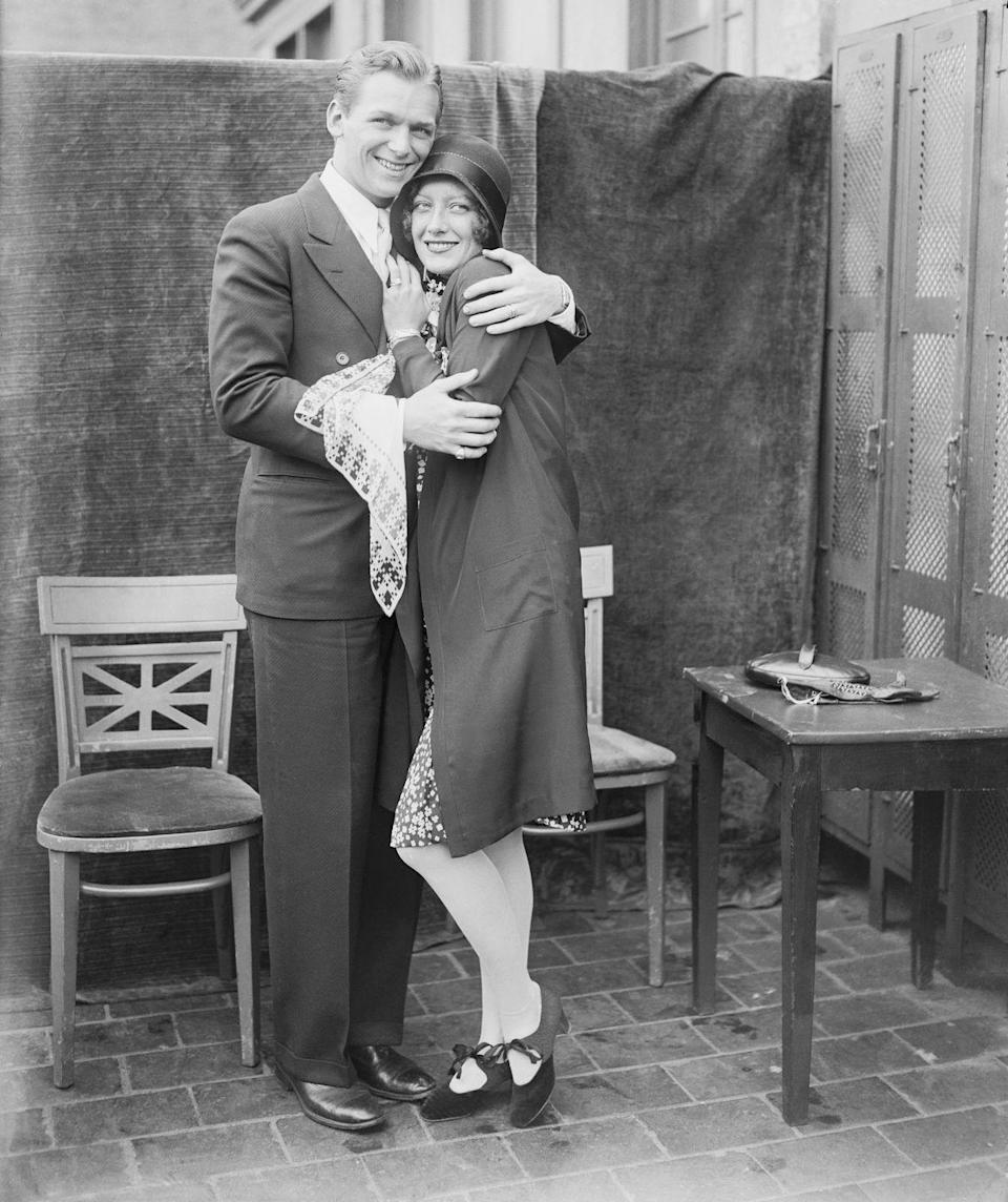"""<p>In 1929, Joan and fellow actor Douglas Fairbanks Jr. <a href=""""https://www.bustle.com/p/joan-crawfords-relationships-spanned-hollywood-her-career-43268"""" rel=""""nofollow noopener"""" target=""""_blank"""" data-ylk=""""slk:surprised the press"""" class=""""link rapid-noclick-resp"""">surprised the press</a> by announcing their marriage.</p>"""