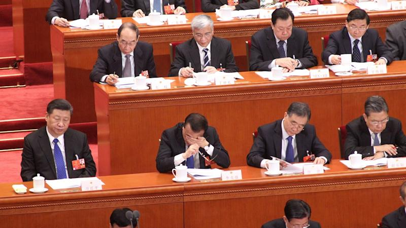 Xi shakes up Chinese government to cut bureaucracy, end turf wars