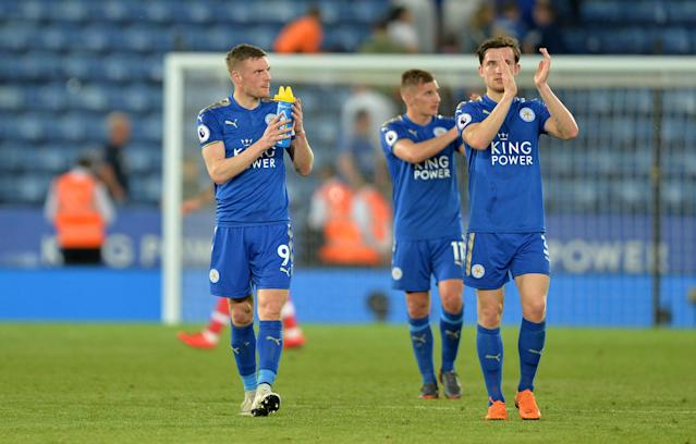 "Soccer Football - Premier League - Leicester City vs Southampton - King Power Stadium, Leicester, Britain - April 19, 2018 Leicester City's Jamie Vardy, Marc Albrighton and Ben Chilwell applaud fans after the match REUTERS/Peter Powell EDITORIAL USE ONLY. No use with unauthorized audio, video, data, fixture lists, club/league logos or ""live"" services. Online in-match use limited to 75 images, no video emulation. No use in betting, games or single club/league/player publications. Please contact your account representative for further details."