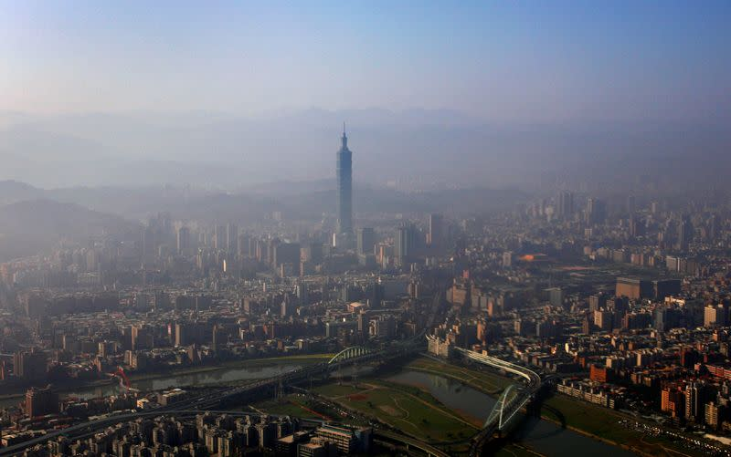 The Taipei 101 building is seen amidst the Taipei city skyline