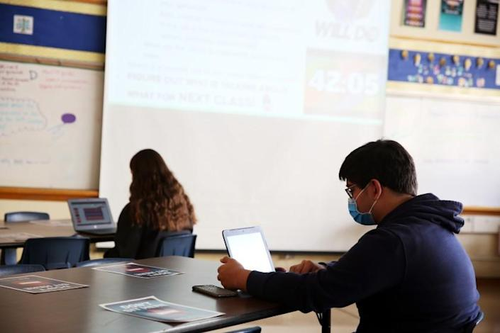 LOS ANGELES, CA - APRIL 21: Students completes classroom during her Justice in America class at Millikan High School where seniors have been allowed back in class and other classes will be invited back on Monday in Long Beach on Wednesday, April 21, 2021 in Los Angeles, CA. Lesson plans are designed around a hybrid of zoom and in-class students. (Dania Maxwell / Los Angeles Times)