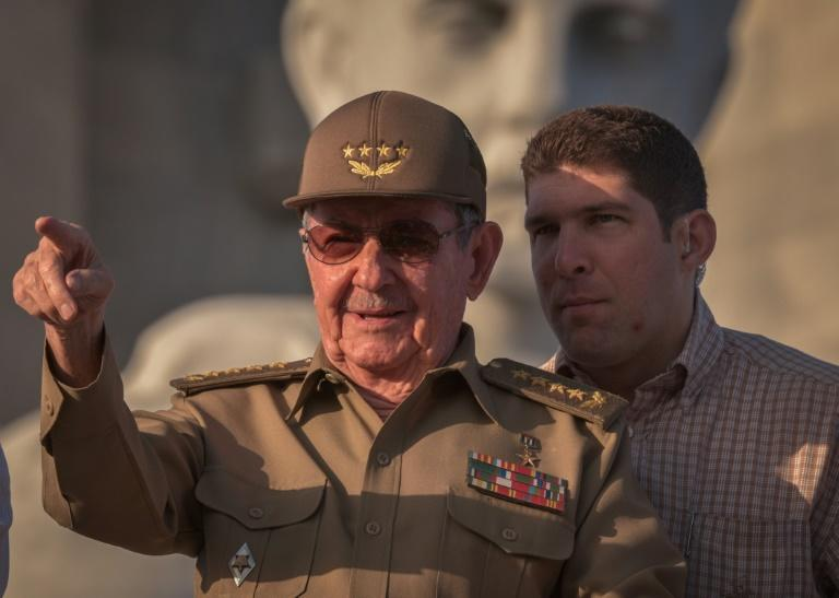 Cuban President Raul Castro, next to his grandson and bodyguard, attends the May Day parade in Havana on May 1, 2017