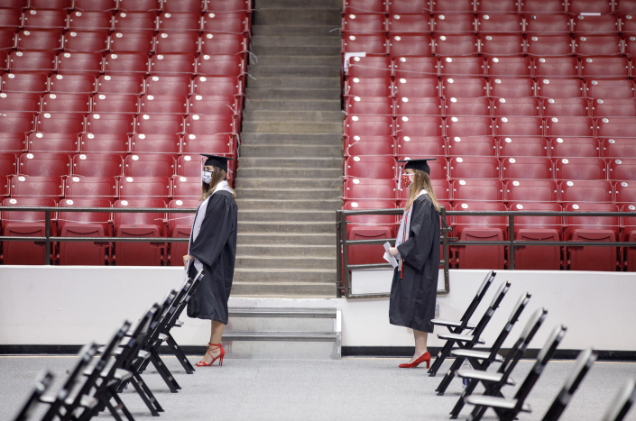 Students maintained six feet of distance as they waited for their diplomas Some students sat in the stands at Coleman Coliseum (Matthew Wood - University of Alabama Photography)