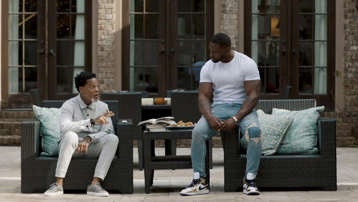 """This image provided by Bounce shows D.L. Hughley, left, and Thomas Q. Jones in a scene from """"Johnson,"""" which premieres Aug. 1, 2021, on Bounce TV. (DeWayne Rogers/Bounce via AP)"""