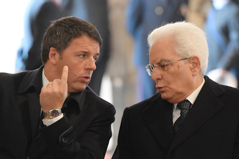 Italy's President Sergio Mattarella (R) speaking with then Prime Minister Matteo Renzi, at St Peter's basilica in the Vatican, on November 20, 2016 (AFP Photo/TIZIANA FABI)