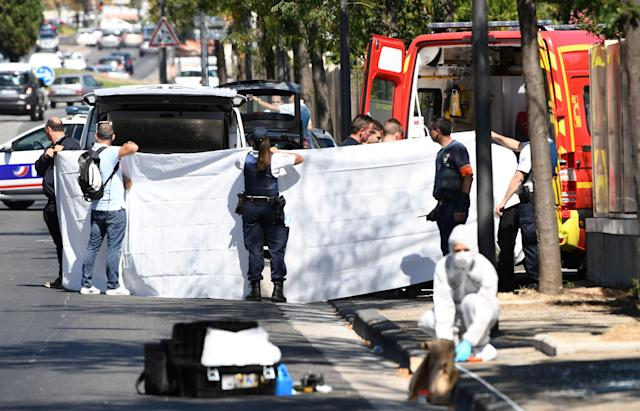 <p>A white sheet is erected as a body of a victim is evacuated to a waiting ambulance while French forensic police officer search the site following a car crash on Aug. 21, 2017, in the southern Mediterranean city of Marseille. (Photo: Boris Horvat/AFP/Getty Images) </p>