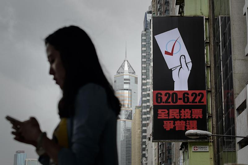 A billboard urging citizens to vote in an unofficial democracy poll in Hong Kong is seen on June 24, 2014