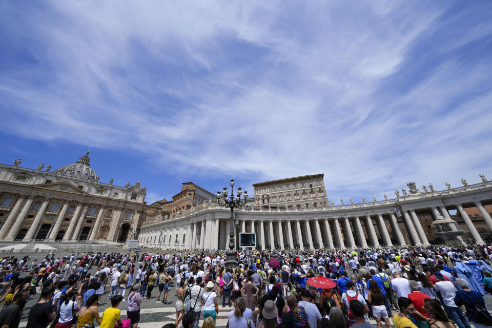 People crowd St.Peter's Square, at the Vatican, as Pope Francis recites the Angelus noon prayer from the window of his studio, top right,, Sunday, June 13, 2021. Francis demanded during his speech for humanitarian aid to reach residents of the war-torn Tigray region of northern Ethiopia, where Ethiopian and Eritrean soldiers are blocking food and other assistance. (AP Photo/Andrew Medichini)