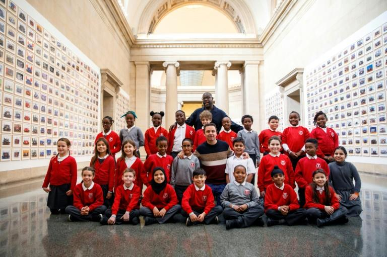 McQueen with pupils from the Tyssen Community School in London