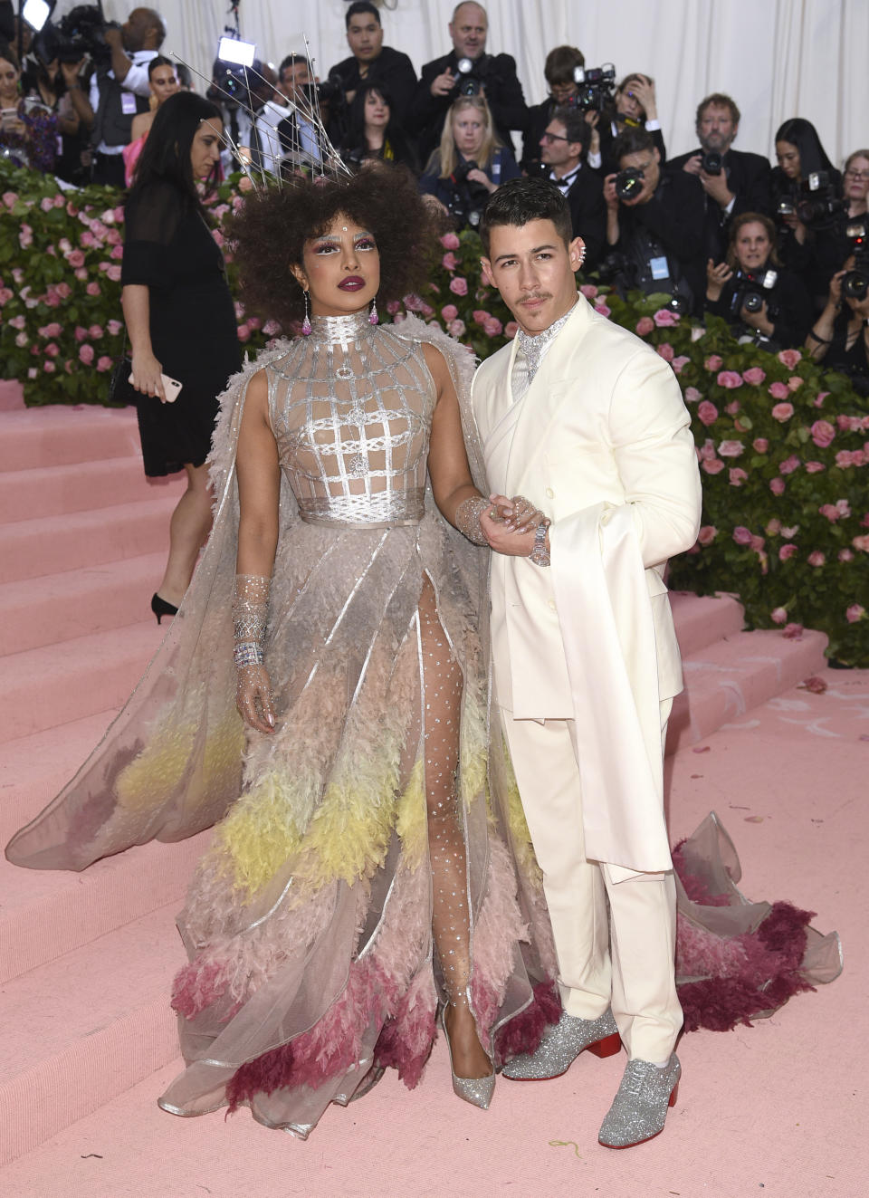 Two years after the 2017 Met Gala, newlyweds Priyanka Chopra and Nick Jonas arrived on Monday night in a pair of regal outfits and matching silver brogues. Photo: Getty Images