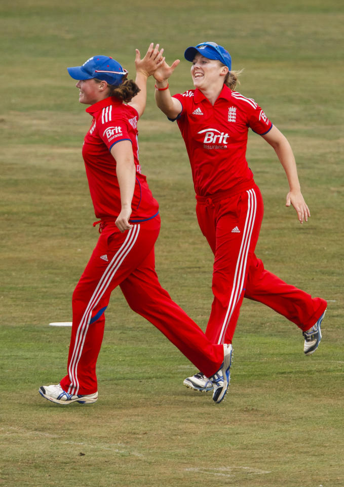 England's Heather Knight (right) celebrates catching Australia's Jodie Fileds during the One Day International at The County Ground, Hove.