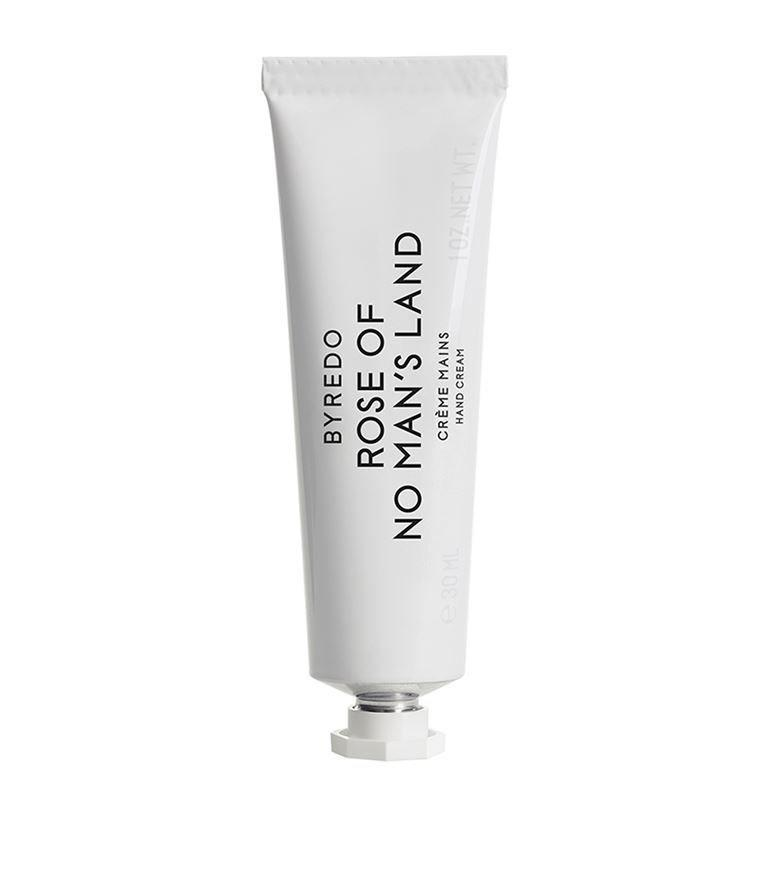 """No one makes a luxury hand cream like Byredo. This subtle rose-scented one never fails to delight people when I pull it out of my bag. And on more than one occasion I've been asked what perfume I'm wearing. (Nothing, it's the cream!) It also feels decadent (but never greasy) on your hands, which is key. I have to yell at my hand-cream-obsessed boyfriend not to go near it because it's so precious to me. <em>—L.S.</em> $43, Nordstrom. <a href=""""https://www.nordstrom.com/s/byredo-rose-of-no-mans-land-hand-cream/5212780"""" rel=""""nofollow noopener"""" target=""""_blank"""" data-ylk=""""slk:Get it now!"""" class=""""link rapid-noclick-resp"""">Get it now!</a>"""