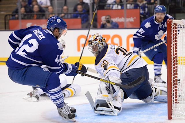 Buffalo Sabres' goalie Ryan Miller blocks an attempt by Toronto Maple Leafs' Tyler Bozak during second period NHL hockey action in Toronto Sunday, Sept. 22, 2013. (AP Photo/THE CANADIAN PRESS, Frank Gunn)