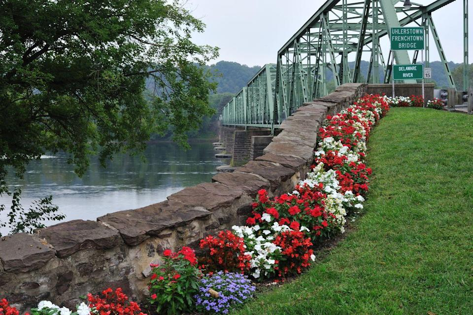 """<p>A visit to <a href=""""https://go.redirectingat.com?id=74968X1596630&url=https%3A%2F%2Fwww.tripadvisor.com%2FTourism-g46454-Frenchtown_New_Jersey-Vacations.html&sref=https%3A%2F%2Fwww.esquire.com%2Flifestyle%2Fg35036575%2Fsmall-american-town-destinations%2F"""" rel=""""nofollow noopener"""" target=""""_blank"""" data-ylk=""""slk:this charming, serene town"""" class=""""link rapid-noclick-resp"""">this charming, serene town</a> might be just what you need. It's a great spot for biking and hiking as well as browsing the local shops. If you visit in July, be sure to check out their Bastille Day festival.</p>"""