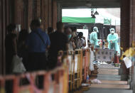 People line up at a rapid coronavirus testing center after the COVID-19 alert raise to level 3 in Taipei, Taiwan, Tuesday, May 18, 2021. (AP Photo/Chiang Ying-ying)
