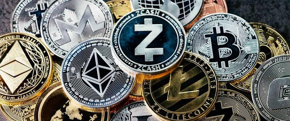 Crypto currency background with various of shiny silver and golden physical cryptocurrencies symbol coins, Bitcoin, Ethereum, Litecoin, zcash, ripple.