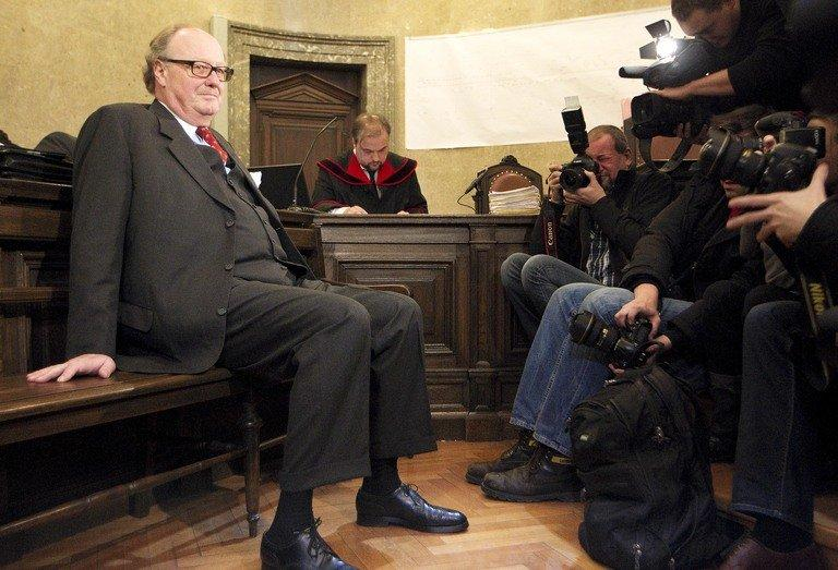 Count Alfons Mensdorff-Pouilly (left) is photographed as he waits for his trial on December 12, 2012 in Vienna