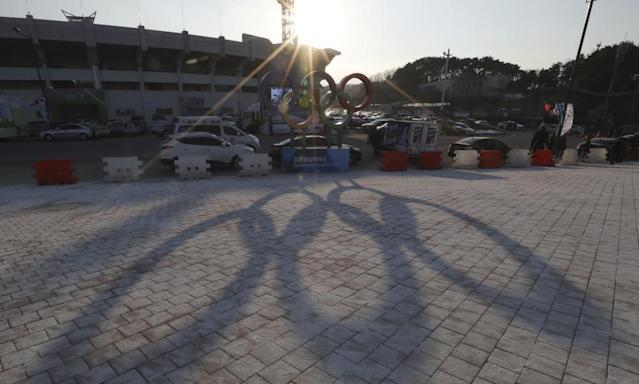 "<span class=""element-image__caption"">The Olympic rings cast a shadow near the 2018 Pyeongchang Winter Olympics venues. </span> <span class=""element-image__credit"">Photograph: Lee Jin-man/AP</span>"
