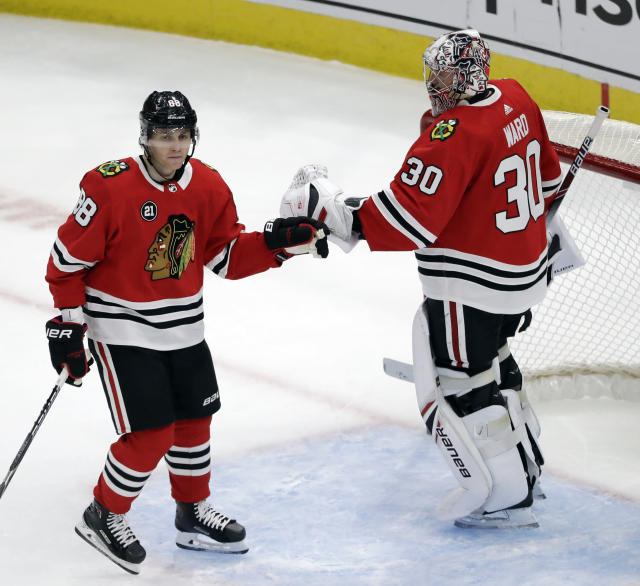 Chicago Blackhawks right wing Patrick Kane, left, celebrates with goalie Cam Ward after scoring a goal against the Detroit Red Wings during the third period of an NHL hockey game Sunday, Feb. 10, 2019, in Chicago. The Blackhawks won 5-2. (AP Photo/Nam Y. Huh)