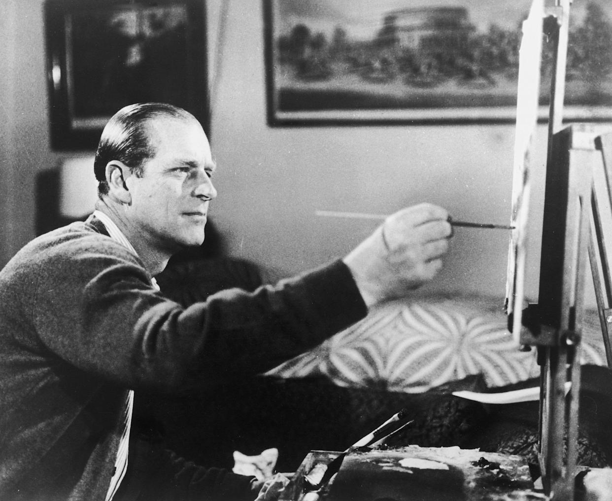 """Prince Philip at work on one of his hobbies, painting, on June 19, 1969, as seen in a scene from the documentary """"Royal Family."""" (Photo: Keystone/Hulton Archive/Getty Images)"""