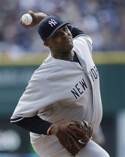 New York Yankees starting pitcher CC Sabathia throws during the first inning of a baseball game against the Detroit Tigers in Detroit, Sunday April 7, 2013. (AP Photo/Carlos Osorio)