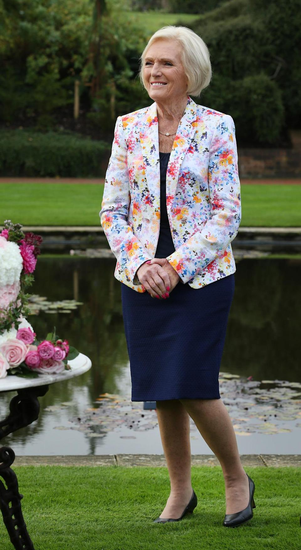 <p>For a day at the RHS Flower Show, Mary opted for a lighter coloured floral blazer, bringing a summery kick to her outfit. </p><p><i>[Photo: Getty]</i></p>