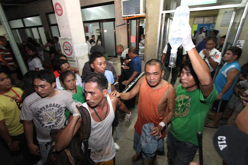 A survivor goes out of a hospital in Cebu, central Philippines late Friday Aug. 16, 2013. Passenger ferry MV Thomas Aquinas with nearly 700 people aboard sank near the central Philippine port of Cebu on Friday night after colliding with a cargo vessel, and a survivor said he saw bodies in the sea. (AP Photo/Chester Baldicantos)