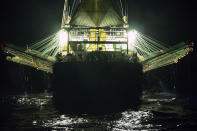 In this July 2021 photo provided by Sea Shepherd, a Chinese-flagged ship fishes for squid at night on the high seas off the west coast of South America. The number of Chinese-flagged vessels in the south Pacific has surged 10-fold from 54 active vessels in 2009 to 557 in 2020, according to the South Pacific Regional Fisheries Management Organization, or SPRFMO, an inter-governmental group of 15 members charged with ensuring the conservation and sustainable fishing of the species. Meanwhile, the size of its catch has grown from 70,000 tons in 2009 to 358,000. (Isaac Haslam/Sea Shepherd via AP)