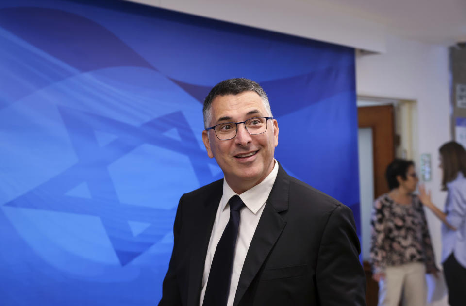 """Israeli Minister of Justice Gideon Saar arrives for the first weekly cabinet meeting of the new government in Jerusalem, Sunday, June 20, 2021. Prime Minister Naftali Bennett opened his first Cabinet meeting on Sunday since swearing in his new coalition government with a condemnation of the newly elected Iranian president, whom he called """"the hangman of Tehran."""" (Emmanuel Dunand/Pool Photo via AP)"""