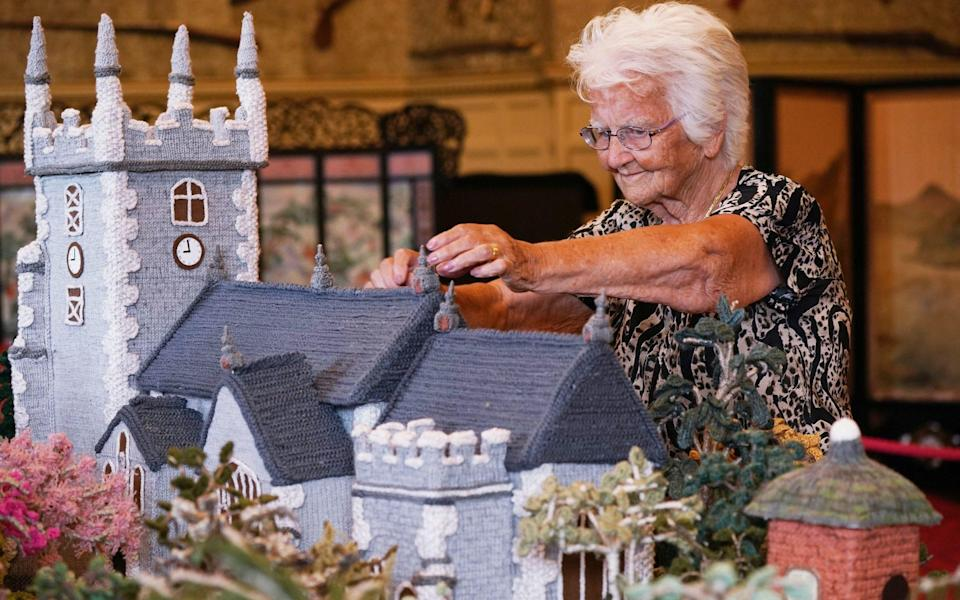 As well as the knitted Sandringham House, the model - which has taken two years to complete - features St Mary Magdalene Church, stables and the nest house - PA
