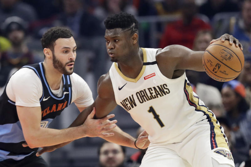 New Orleans Pelicans' Zion Williamson (1) drives past Cleveland Cavaliers' Larry Nance Jr. during the first half of an NBA basketball game Tuesday, Jan. 28, 2020, in Cleveland. (AP Photo/Tony Dejak)
