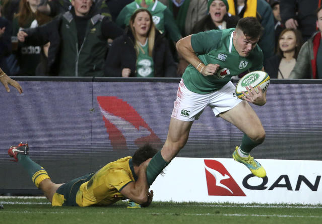 Ireland's Jacob Stockdale, right, breaks a tackle from Australia's Nick Phipps during their rugby union test match in Sydney, Saturday, June 23, 2018. (AP Photo/Rick Rycroft)