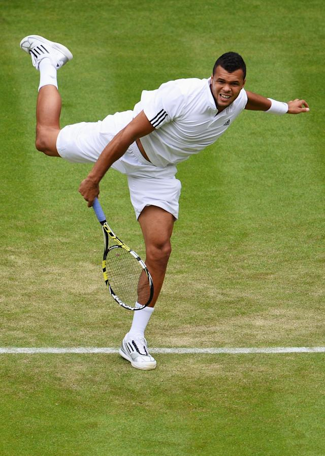 LONDON, ENGLAND - JUNE 26: Jo-Wilfried Tsonga of France serves during his Gentlemen's Singles second round match against Ernests Gulbis of Latvia on day three of the Wimbledon Lawn Tennis Championships at the All England Lawn Tennis and Croquet Club on June 26, 2013 in London, England. (Photo by Mike Hewitt/Getty Images)