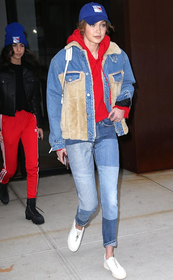 <p>On 12 March 2018, Gigi Hadid brought a whole new meaning to airport style in a shearling denim jacket and patchwork jeans in the same hue. <em>[Photo: Rex]</em> </p>